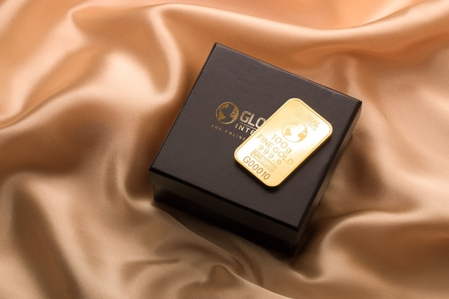 Engraved bar of gold on a black box